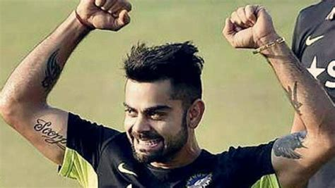 photo virat kohli flaunts his biceps and tattoos