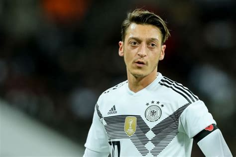 haircut deals north london arsenal news mesut ozil sends raphael varane back to