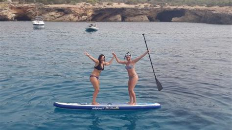 catamaran traduccion en ingles our friends using the paddle board that comes with the