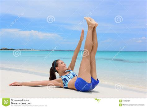 abs exercise fitness woman toe touch crunches stock