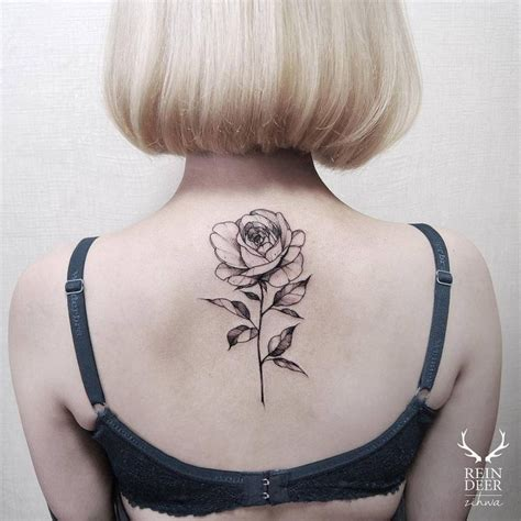 blackwork illustrative rose tattoo on the upper back