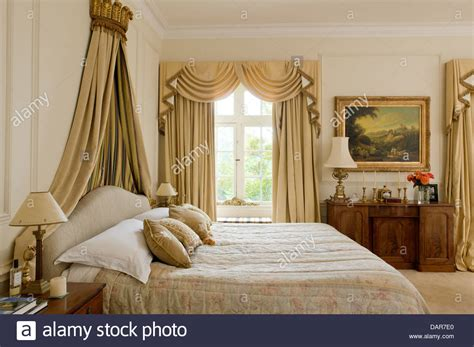 gold curtains bedroom bed with gilt coronet in bedroom with full length pale