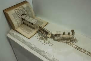 book sculpture illustrates ocd derailed typography train