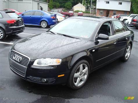 brilliant black audi   quattro sedan
