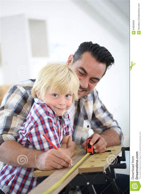 father son projects father and son working on diy projects at home stock image