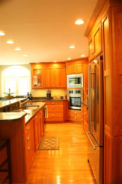 a wall built in microwave cabinet keeps counter clear and cherry wood cabinet kitchen stainless steel appliances