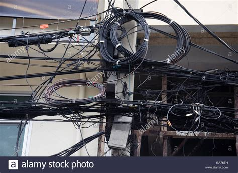 wires messy  power  cables transformers  phone lines stock photo royalty