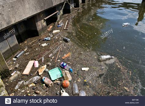 thames river london ontario pollution floating rubbish and pollution in the river thames stock