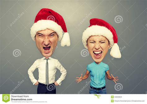 wallpaper of emotional couple emotional couple in santa hat over dark stock images