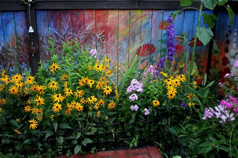 Best Paint For Wall Mural i revived our old garden fence by painting vivid flowers
