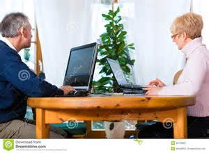 work at home for seniors seniors at home working on computer royalty free stock