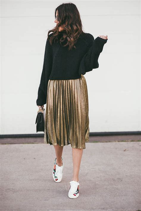 black sweater and gold pleated skirt style