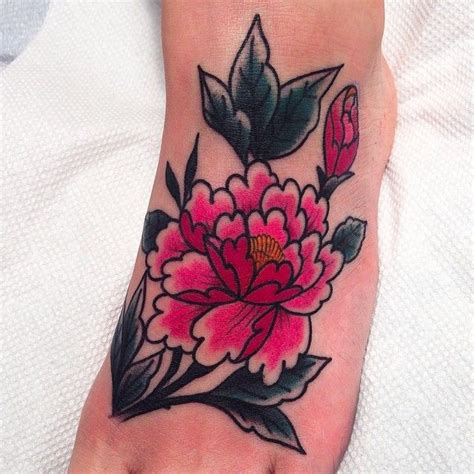 hand tattoo leaking classic american flower in pink idle hands tattoo ink