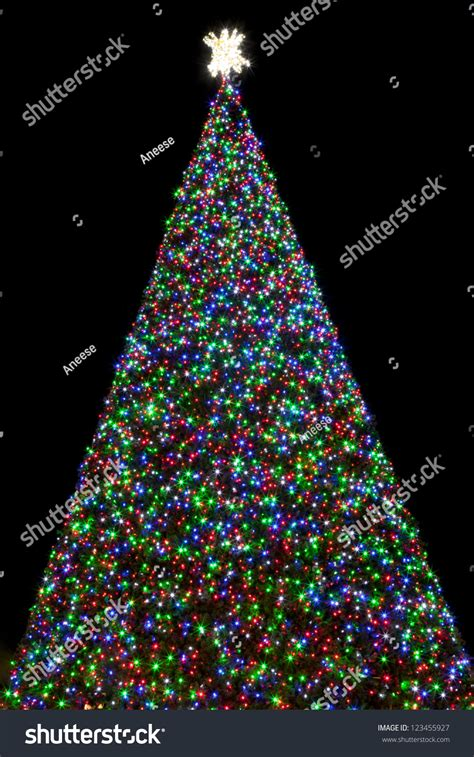 green christmas tree with blue lights 100 ft christmas tree covered red stock photo 123455927