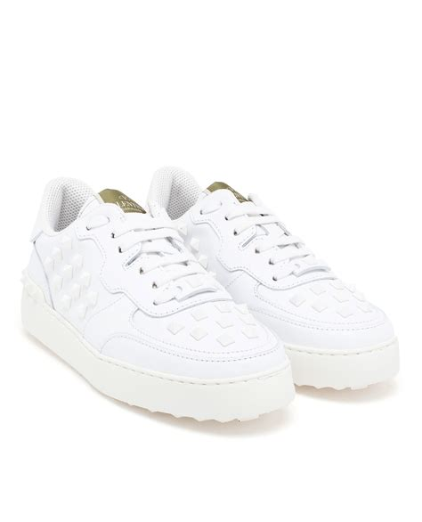 all white sneakers for lyst valentino rockstud trainers in white