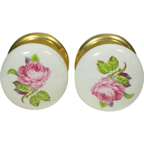 pair of floral ceramic gainsborough door knobs from