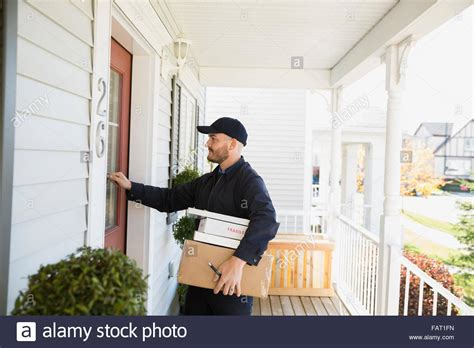 Front Door Delivery Delivery With Packages Knocking At Front Door Stock Photo Royalty Free Image 92726473 Alamy