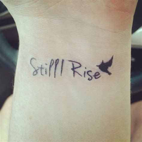 still i rise wrist tattoo inspired by maya angelou