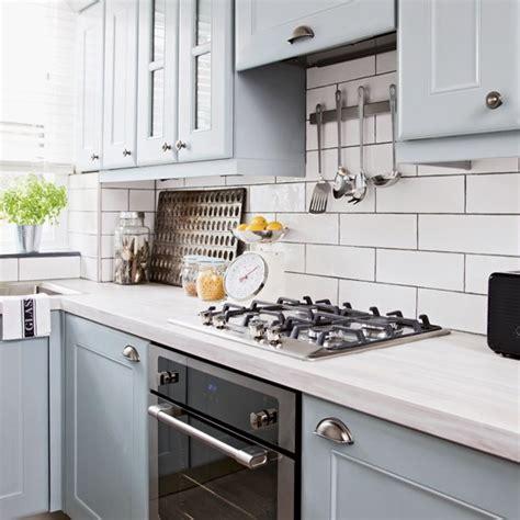 White Metro Tiles Kitchen - pale blue kitchen with white metro tiles and black oven black ovens metro tiles and kitchens