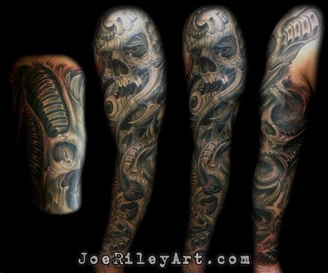 biomech sleeve with skulls by joe riley tattoonow