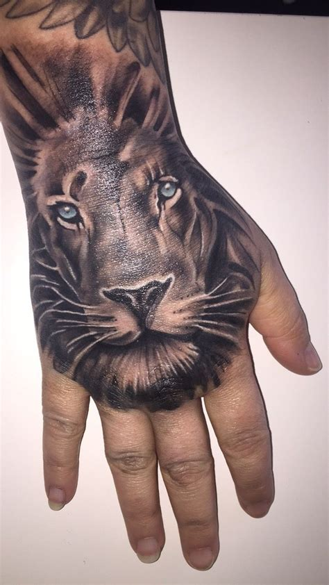 lion tattoo on hand 25 best ideas about on
