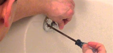 removing a bathtub drain plug how to remove drain stopper to better unclog a bathtub
