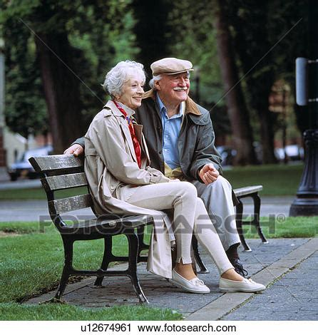 old couple on bench stock photography of old couple sitting on park bench together u12674961 search