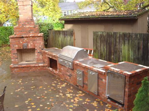 Brick Outdoor Kitchen Pics - outdoor fireplace with outdoor kitchen traditional
