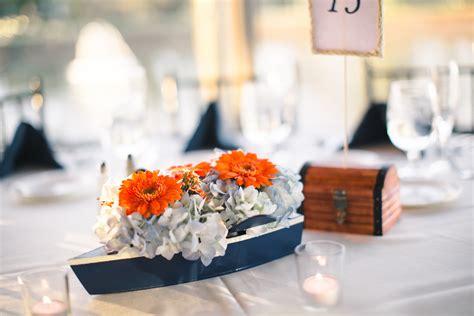 boat centerpieces gerber daisies waxflower and hydrangeas were displayed in