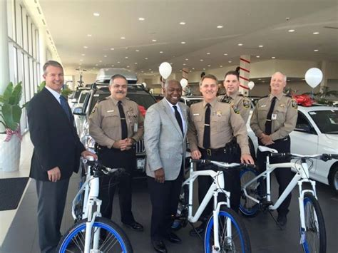moorehead bmw of sterling loudoun county sheriff s office receives bicycle donation