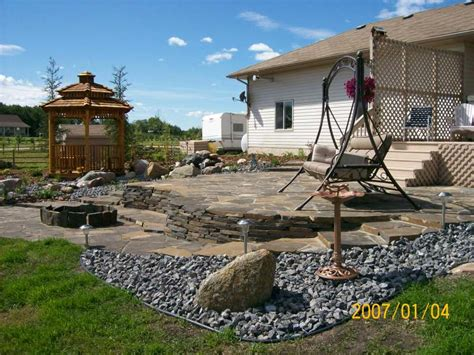 How To Level A Backyard With A Slope by Patio Landscaping Ideas