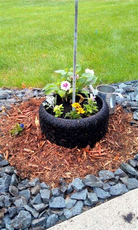 tire flower beds repurposed lawn mower tire flower pot at the base of my