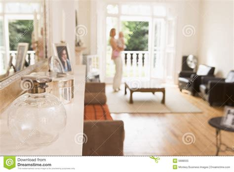 last standing living room standing in living room holding baby stock image image 5688555