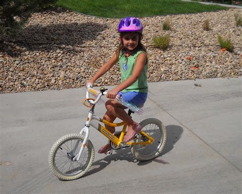 bike riding kid riding bike with training wheels