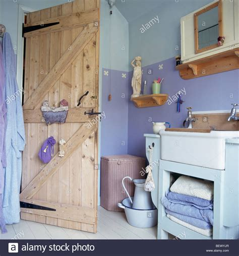 two tone paint bathroom walls stripped pine door in cottage bathroom with two tone