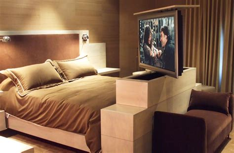beds with tv in footboard under over the bed lifts vs ceiling or footboard tv lifts