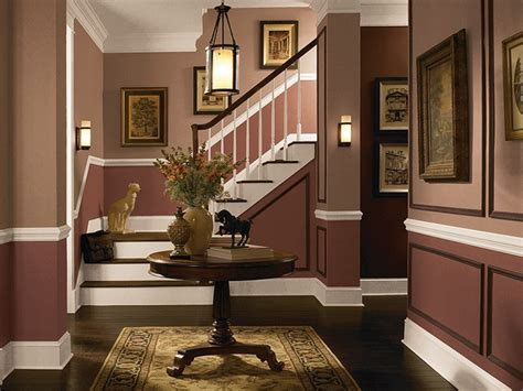 these earth tone colors add a sense of warmth and sophistication to the entryway traditional