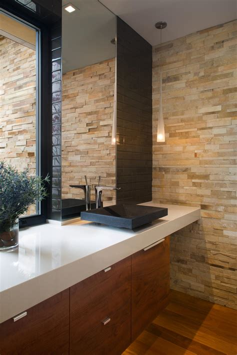 contemporary living room with stacked stone accent wall photos hgtv contemporary stairway with stacked stone wall