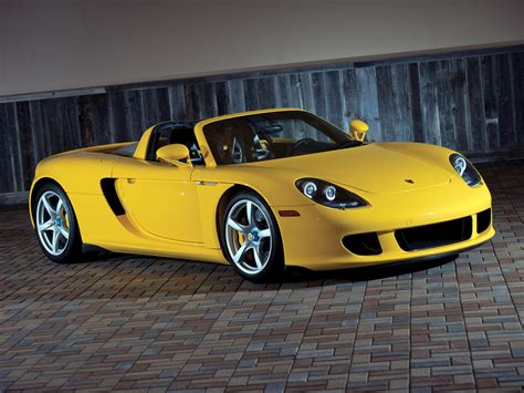 2004 porsche carrera gt to go across the block at race retro auction practical motoring 2004 2006 porsche carrera gt history review top speed