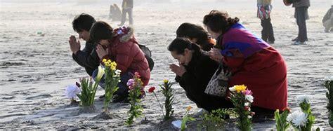 Relatives offer one minute of silent prayer on Sunday for