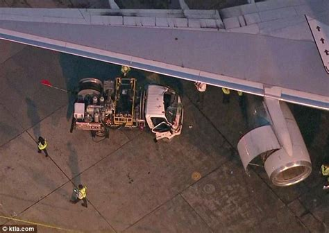 fuel truck driver cut free after crash into american airlines jet at lax daily mail