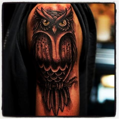 owl tattoo on woman s arm powerful owl tattoo 2 owl foot tattoo on tattoochief com