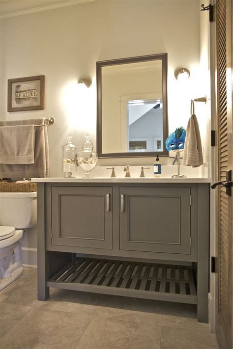 This bathroom features a painted maple inset cabinet