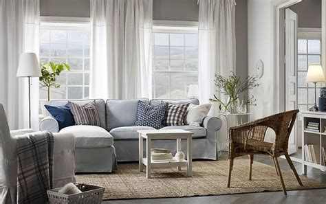 media room chaise lounges a light living room furnished with a light blue two seat