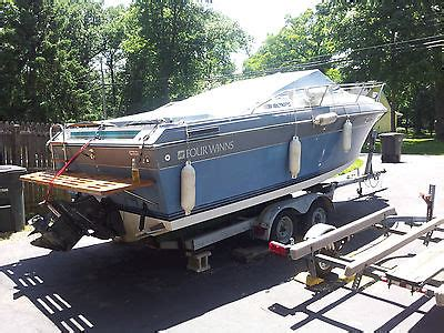 boat motor repair muskegon mi four winns 235 sundowner boats for sale
