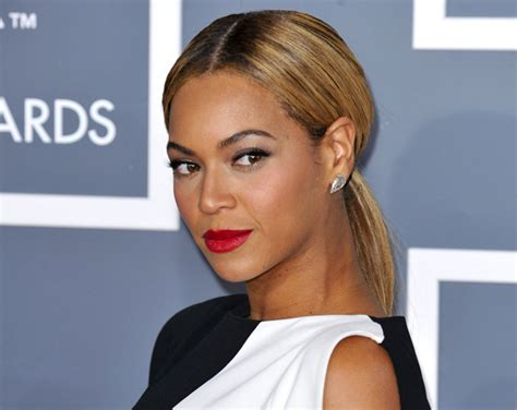 kim kardashians low sleek ponytail with center part celebrity on trend the low ponytail hairdressers milton keynes