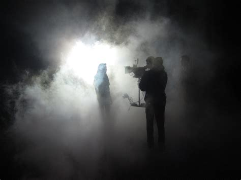 a singer in a smoky room creating a smoke screen for a new look rosco spectrum