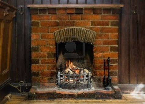What To Do With Old Fireplace | 13049567 old brick fireplace burning logs jpg 1 200 215 867
