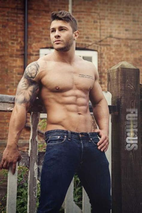 tattoos for muscular men gazes at the next building photo by