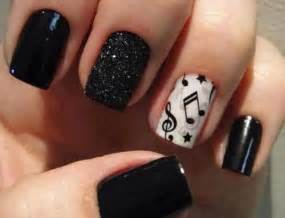 Black nails embellished with black sparkles and music notes nail art